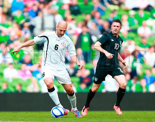 02.06.2013 Dublin, Ireland. Zurab Khizanishvili (Georgia) holds up the ball during the International friendly game between the Rep. of Ireland and Georgia from the Aviva Stadium.