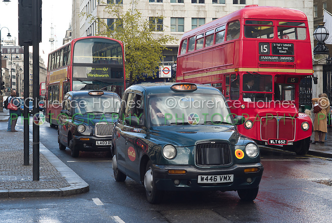 Routemaster double decker bus operating on heritage route 15 in traffic in front of Charing Cross Station, London, England