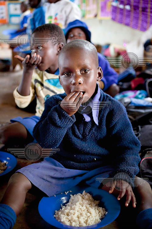 Nursery school children eat lunch at Zvehuru primary school.