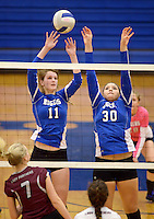 NWA Democrat-Gazette/BEN GOFF @NWABENGOFF<br /> Hannah Martin (11) and Audrey Herrera of Rogers block a ball spiked by Shaylon Sharp of Siloam Springs on Thursday Aug. 27, 2015 during the match at Rogers High.