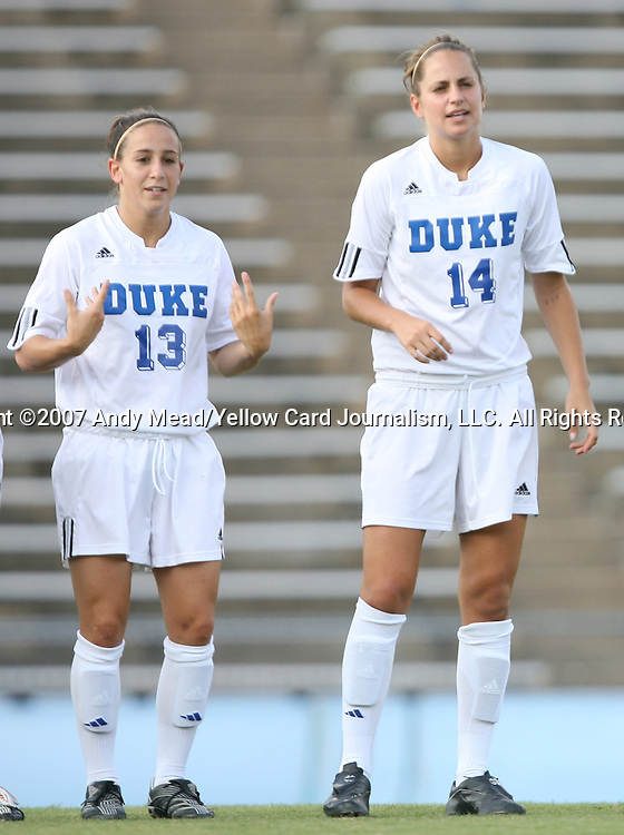 07 September 2007: Duke's Lorraine Quinn (13) and Christie MacDonald (14). The Duke University Blue Devils defeated the Yale University Bulldogs 1-0 at Fetzer Field in Chapel Hill, North Carolina in an NCAA Division I Women's Soccer game, and part of the annual Nike Carolina Classic tournament.