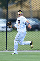 GCL Tigers outfielder Adrian Castano (21) tracks down a fly ball during a game against the GCL Blue Jays on June 30, 2014 at Tigertown in Lakeland, Florida.  GCL Blue Jays defeated the GCL Tigers 3-1.  (Mike Janes/Four Seam Images)