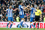 Real Sociedad's Alberto de la Bella, Ruben Pardo and Xabi Prieto celebrate goal in presence of the spanish  referee Ignacio Iglesias Villanueva during La Liga match.January 06,2013. (ALTERPHOTOS/Acero)