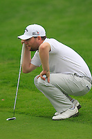 Branden Grace (RSA) on the 9th green during Thursday's Round 1 of the 2014 BMW Masters held at Lake Malaren, Shanghai, China 30th October 2014.<br /> Picture: Eoin Clarke www.golffile.ie