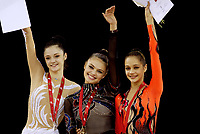 Budapest, Hungary, September 25, 2003 (UPI) -- All-Around winners (L-R) ANNA BESSONOVA of Ukraine (Silver), ALINA KABAEVA of Russia (Gold), IRINA TCHACHINA of Russia (Bronze) at 2003 Rhythmic Gymnastics World Championships.