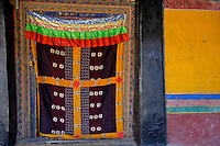 The colors of the Tibetan Monestries and Temples in Tibet,.The Jokhang Temple is one of Tibet's holiest shrines, originally built in 647 A.D. in celebration of the marriage of the Tang Princess Wencheng and the Tubo King Songtsen Gampo. In front of the gate is a stone Tablet of Unity from the Tang Dynasty; inscribed are both Chinese characters and Tibetan script. Nearby is the stump of the willow tree said to have been planted by Princess Wencheng herself; two younger willow trees now flank the stump of the first tree...Located in the center of old Lhasa, the temple was built by craftsmen from Tibet, China, and Nepal and thus features different architectural styles. The temple is also the spiritual center of Tibet and the holiest destination for all Tibetan Buddhist pilgrims. In the central hall is the Jokhang's oldest and most precious object--a gold statue of a seated 12-year-old Sakyamuni. This is said to have been transported to Tibet by Princess Wencheng from her home in Changan in 700 A.D. Other precious antiques in the temple include a silk portrait of Buddha from the Tang Dynasty and a pearl gown and gold lamp from the Ming Dynasty. The three-leafed roof of the Jokhang offers splendid views of the bustling Barkhor market and across to the Potala Palace..