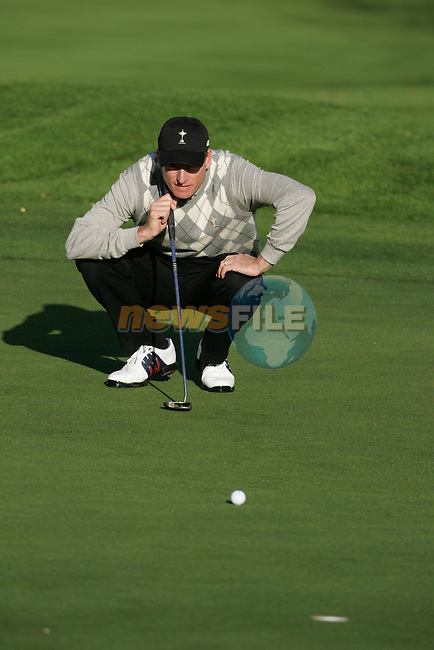 Straffin Co Kildare Ireland. K Club Ruder Cup...American Ryder Cup team member Jim Furyk lineing up Tiger Woods putt on the forth green  during the opening fourball session of the first day of the 2006 Ryder Cup, at the K Club in Straffan, Co Kildare, in the Republic of Ireland, 22 September 2006..Photo: Fran Caffrey/ Newsfile.<br />