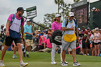 Tommy Fleetwood (ENG) and the caddies share a laugh as they head down 1 during round 4 of The Players Championship, TPC Sawgrass, at Ponte Vedra, Florida, USA. 5/13/2018.<br /> Picture: Golffile | Ken Murray<br /> <br /> <br /> All photo usage must carry mandatory copyright credit (&copy; Golffile | Ken Murray)