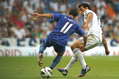 19.08.2012 Madrid, Spain. La Liga Football Real Madrid vs. Valencia CF - Piatti controls the ball in front of Arbeloa