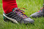 © Joel Goodman - 07973 332324 . 22/09/2013 . Lancing , UK . Shadow Chancellor Ed Balls ' rainbow laces worn in support of an anti homophobia in football campaign . Labour Party vs journalists football match . Day 1 of the Labour Party 's annual conference in Brighton . Photo credit : Joel Goodman