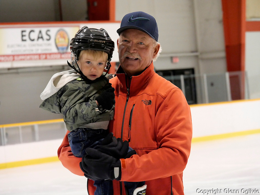 "Steve Hicken, of Sarnia with his two-year-old grandson Keaton a.k.a.""Buster"" Garvin.<br /> <br /> Hicken said he played a lot of local hockey when he was young including pick-up hockey and some travel as well. <br /> <br /> ""I have four grandchildren, three of them girls who don't like hockey,"" he said "" It's really important to me and Keaton seems to like skating."""