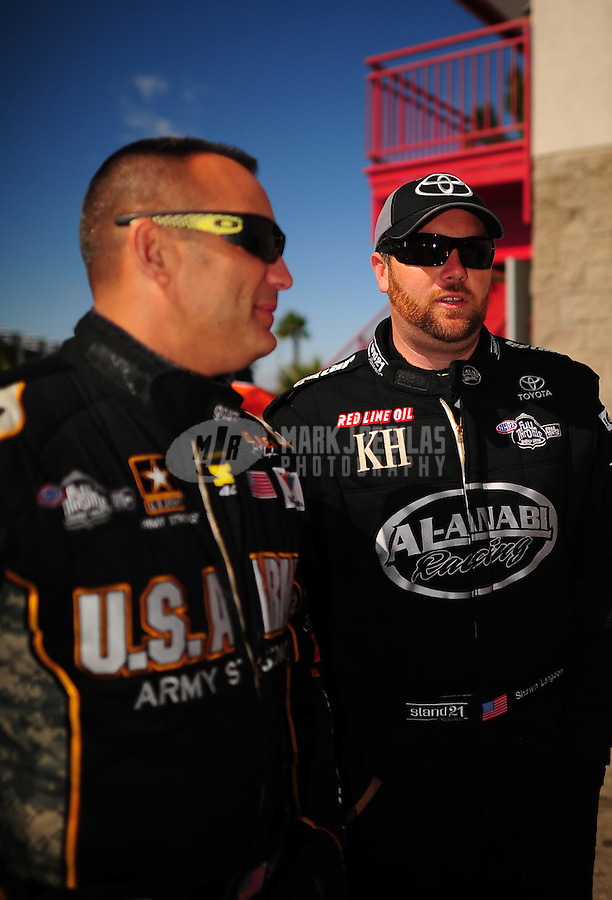 Apr. 1, 2012; Las Vegas, NV, USA: NHRA top fuel dragster driver Shawn Langdon (right) with Tony Schumacher during the Summitracing.com Nationals at The Strip in Las Vegas. Mandatory Credit: Mark J. Rebilas-
