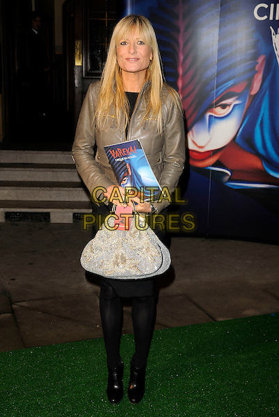 "GABY ROSLIN .Attending the Cirque Du Soleil ""Varekai"" Premiere at the Royal Albert Hall, London, England, January 8th 2007..full length grey leather biker jacket bag silver.CAP/CAN.©Can Nguyen/Capital Pictures"