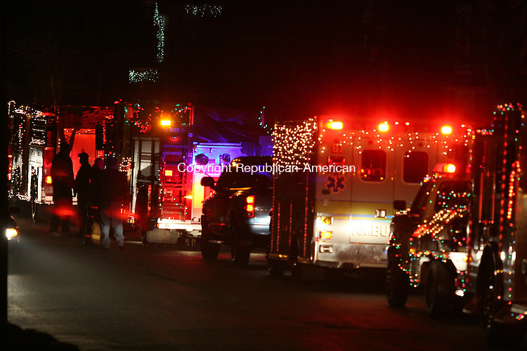WINSTED, CT - 27 December, 2008 - 122708MO06 - Decorated fire trucks and other emergency vehicles circled Winsted during the annual Gator Parade Saturday. Jim Moore Republican-American.