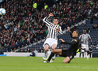 Kelvin Wilson gets to the ball before Steven Thompson in the St Mirren v Celtic Scottish Communities League Cup Semi Final match played at Hampden Park, Glasgow on 27.1.13.