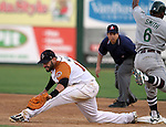 SIOUX FALLS, SD - JUNE 5:  Cesar Nicolas #18 from the Sioux Falls Pheasants stretches for the ball to get the out at first on Sean Smith #6 from the Gary Southshore Railcats in the third inning Tuesday night at the Sioux Falls Stadium. (Photo by Dave Eggen/Inertia)