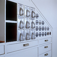 In the kitchen custom-made drawers and circular storage bins are faced in functional zinc with engraved metal labels