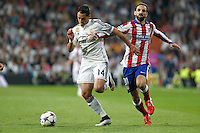 Real Madrid´s Mexican forward Chicharito and Atletico Madrid´s Spanish defense Juanfran Torres