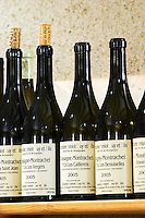 bottles on shelf dom g amiot & f chassagne-montrachet cote de beaune burgundy france
