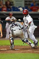 Tri-City ValleyCats catcher Gabriel Bracamonte (24) catches a throw as Daniel Johnson (30) attempts to score during a game against the Auburn Doubledays on August 25, 2016 at Falcon Park in Auburn, New York.  Tri-City defeated Auburn 4-3.  The third out was recorded before the play at the plate.  (Mike Janes/Four Seam Images)