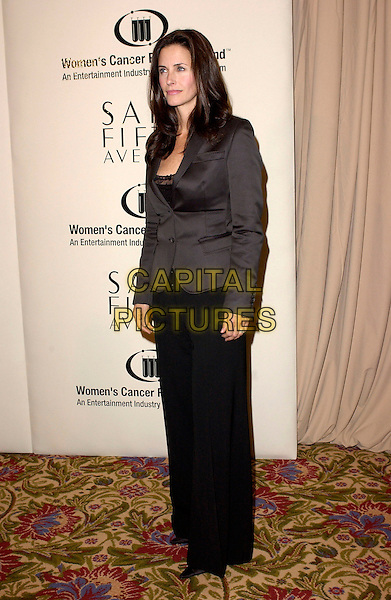 COURTENEY COX ARQUETTE.The Saks Fifth Avenue's Unforgettable Evening honouring Lance Armstrong by Entertainment Industry Foundation's Women's Cancer Fund held at The Regent Beverly Wiltshire in Beverly Hills, California  .March 1st, 2005.full length black suit jacket trousers courtney.www.capitalpictures.com.sales@capitalpictures.com.Supplied By Capital PIctures