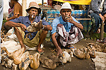 Two men sells ducks at a market in Kopang, Lombok, Indonesia.