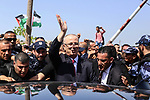 (FILES) In this file photo taken on October 2, 2017 shows Palestinian prime minister Rami Hamdallah is surrounded by security as he arrives at the Erez border crossing in the northern Gaza Strip. An explosion has struck the convoy of Palestinian Prime Minister Rami Hamdallah upon his entrance into the Gaza Strip on Tuesday March 13, 2018 lightly injuring several people. The explosive device detonated shortly after Hamdallah and his convoy passed through the Beit Hanoun checkpoint with Israel in northern Gaza. Photo by Mofeed AboZaida