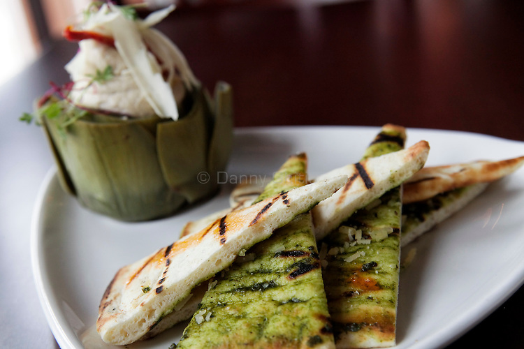 An appetizer of white beans and artichoke dip with parmesan shaves and flat bread at Aperitif, a French bistro in Rockville Centre that specializes in small dishes and wines. .(October 15, 2010).Photo by Danny Ghitis