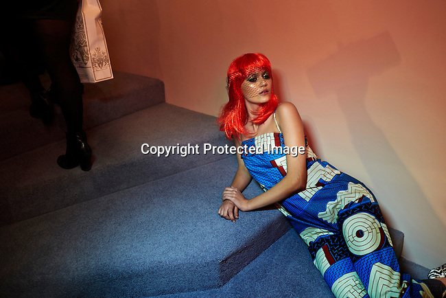 CAPE TOWN, SOUTH AFRICA - JULY 26: A model rests in the stairs during an installation show at the new Klûk CGDT flagship store during Mercedes-Benz Fashion Week on July 26, 2014, in Cape Town, South Africa. Klûk CGDT, created by the designers Malcolm KLûK and Christiaan Gabriel Du Toit. The elite of Cape Town came out for the launch of the store and the late night party. (Photo by Per-Anders Pettersson)