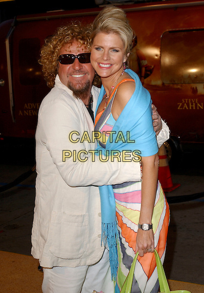 """SAMMY HAGAR & WIFE.Attends Paramount Pictures' Los Angeles Premiere of """"Sahara"""" held at The Grauman's Chinese Theatre in Hollywood, Los Angeles, California, USA,.April 4th 2005..half length hugging sunglasses peace sign gesture funny dark glasses shades.Ref: DVS.www.capitalpictures.com.sales@capitalpictures.com.©Debbie VanStory/Capital Pictures"""