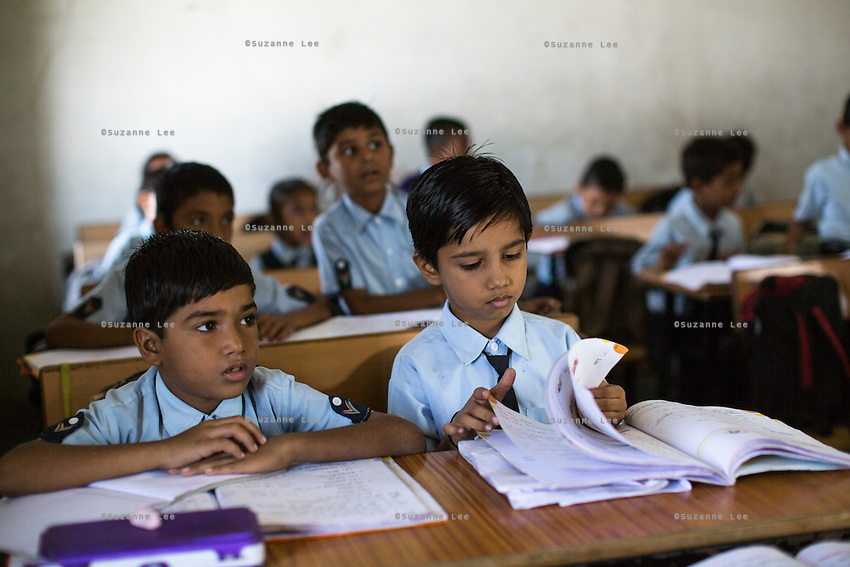 6 year old students study in class in the Vasudha Vidya Vihar school in Khargone, Madhya Pradesh, India on 12 November 2014. Fairtrade farmers get a 5% discount on school fees because the school was built using the Fairtrade Premium. Photo by Suzanne Lee for Fairtrade