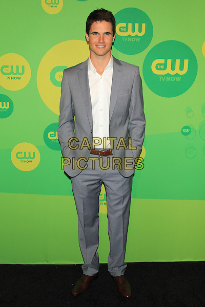 Robbie Amell.At The CW Upfront 2013 Green Carpet Arrivals outside the London Hotel, New York, NY, USA, May 16th, 2013..full length grey gray suit white shirt hands in pockets .CAP/LNC/TOM.©TOM/LNC/Capital Pictures.