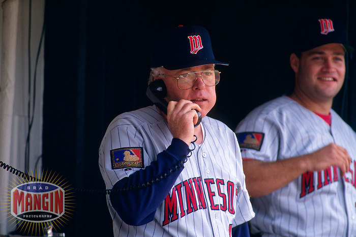 OAKLAND, CA - Manager Tom Kelly of the Minnesota Twins talks on the phone in the dugout during a game against the Oakland Athletics at the Oakland Coliseum in Oakland, California in 1994. Photo by Brad Mangin