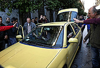 "Pictured: Taxi drivers on strike argue with one of their colleagues who is not on strike in central Athens, Greece. Tuesday 06 March 2018<br /> Re: Taxi drivers have attacked Uber vehicles while protesting against Uber operating in Athens, Greece.<br /> Taxi drivers will on strike for nine hours on Tuesday8 a.m. to 5 p.m. in protest at what they call unfair competition from Uber taxi services.<br /> In a statement, the SATA union representing cab drivers in Attica also expressed dismay at delays in passing a Transport Ministry bill to reorganize their sector and derided ""innovative platforms that rob taxi drivers and the country."""