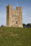 Orford castle, Suffolk, England was built between 1165 and 1173 by Henry II of England to consolidate royal power in the region. The well-preserved keep still stands among the earth-covered remains of the outer fortifications.