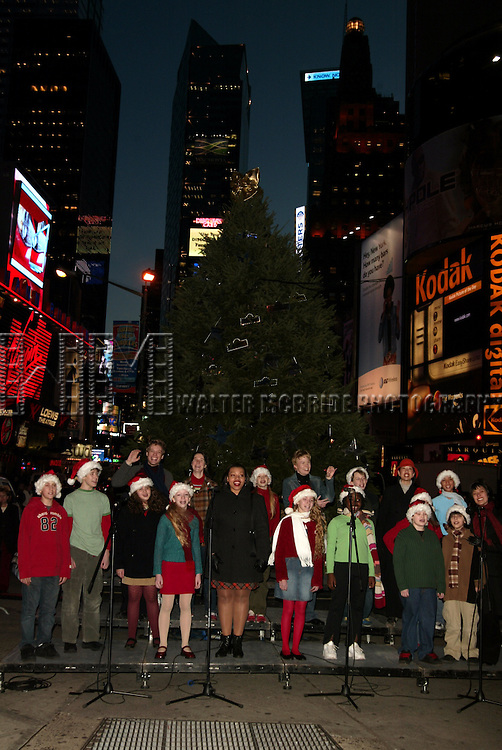Avenue Q Cast Members, Foa Barratt, Carmen Ruby Floyd & Jennifer Barnhart with students from the Professional Performing Arts School help light the 2004 Broadway Holiday Tree at Duffy Square in Times Square, New York City..December 8, 2004.© Walter McBride /  Lttd.