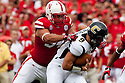 03 Sep 2011: Cameron Meredith #34 of the Nebraska Cornhuskers sacks B.J. Coleman #19 of the Chattanooga Mocs during the frist quarter at Memorial Stadium in Lincoln, Nebraska. Nebraska defeated Chattanooga 40 to 7.