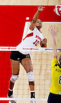 Wisconsin Badgers Alexis Mitchell (10) hits the ball during an NCAA volleyball match against the Michigan Wolverines at the Field House on October 30, 2010 in Madison, Wisconsin. Michigan won the match 3-1. (Photo by David Stluka)