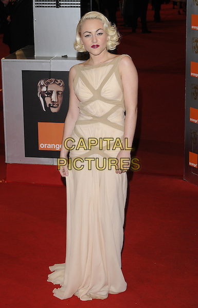 JAMIE WINSTONE.Arrivals at the Orange British Academy Film Awards 2010 at the Royal Opera House, Covent Garden, London, England..February 21st, 2010.BAFTA BAFTAs full length beige sleeveless maxi dress brown peach.CAP/CAN.©Can Nguyen/Capital Pictures.