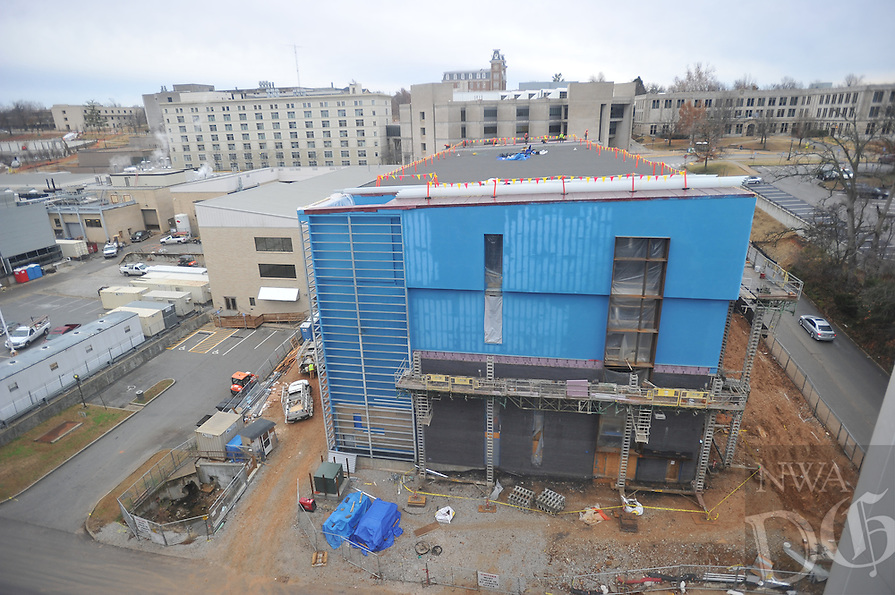 NWA Media/Michael Woods --12/23/2014-- w @NWAMICHAELW...Construction workers continue to work on Champions Hall on Dickson Street on the University of Arkansas campus Tuesday afternoon in Fayetteville.  The new campus building is expected to be completed in the Summer of 2015.