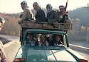 Iran 1979.Transport of peshmergas in a van