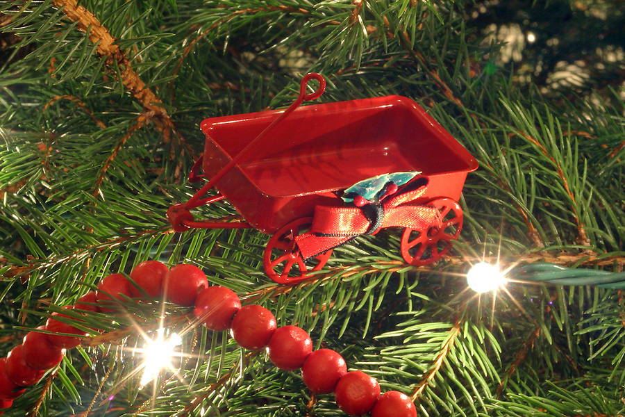 Red wagon ornament on Christmas tree