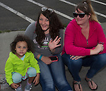 3-year-old Kelynda, Kathy and Bonnie watch the Reno Rodeo Parade held in Midtown on Virginia Street on Saturday, June 18, 2016.