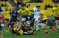 Jordie Barrett pops a pass up to Fletcher Smith during the Super Rugby Aotearoa match between the Hurricanes and Highlanders at Sky Stadium in Wellington, New Zealand on Sunday, 12 July 2020. Photo: Dave Lintott / lintottphoto.co.nz