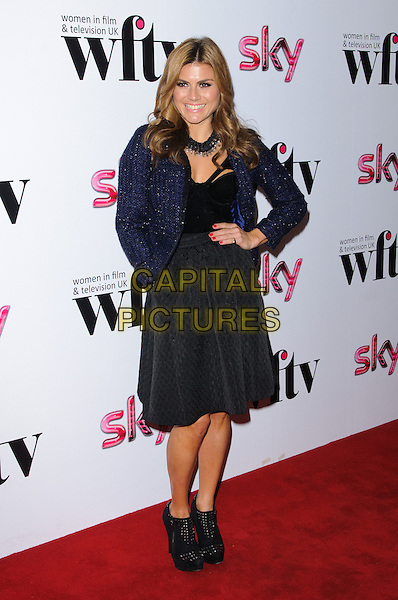Zoe Hardman.Women In Film & Television Awards 2012 held at the Hilton, London, England, UK, 7th December 2012..full length blue jacket hand on hip black skirt top ankle boots shoes .CAP/CJ.©Chris Joseph/Capital Pictures.