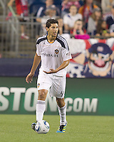Los Angeles Galaxy defender Omar Gonzalez (4) looks to pass. In a Major League Soccer (MLS) match, the Los Angeles Galaxy defeated the New England Revolution, 1-0, at Gillette Stadium on May 28, 2011.