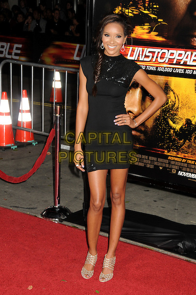 "ELIZABETH MATHIS' shoes.""Unstoppable"" Los Angeles Premiere held at the Regency Village Theatre, Westwood, California, USA..October 26th, 2010.full length black dress hand on hip beige open peep toe shoes cut out sequined sequin polo neck smiling plait hair braid.CAP/ADM/BP.©Byron Purvis/AdMedia/Capital Pictures."