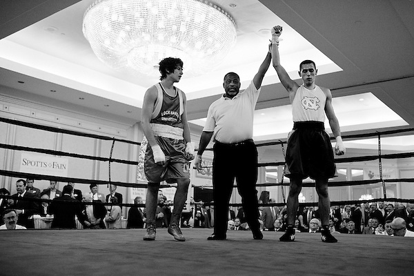 November 15, 2010. Richmond, VA.. Four college boxing teams, from UNC, VMI, Navy and Lockhaven, participated in a charity boxing smoker at the Omni Richmond. The teams fought 7 fights in a cigar smoke filled room full of business men who paid a minimum of $100 to come to the event, drink, smoke and watch the fights..