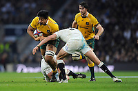 Will Skelton of Australia is tackled by Chris Robshaw and Tom Wood of England during the QBE International match between England and Australia at Twickenham Stadium on Saturday 29th November 2014 (Photo by Rob Munro)
