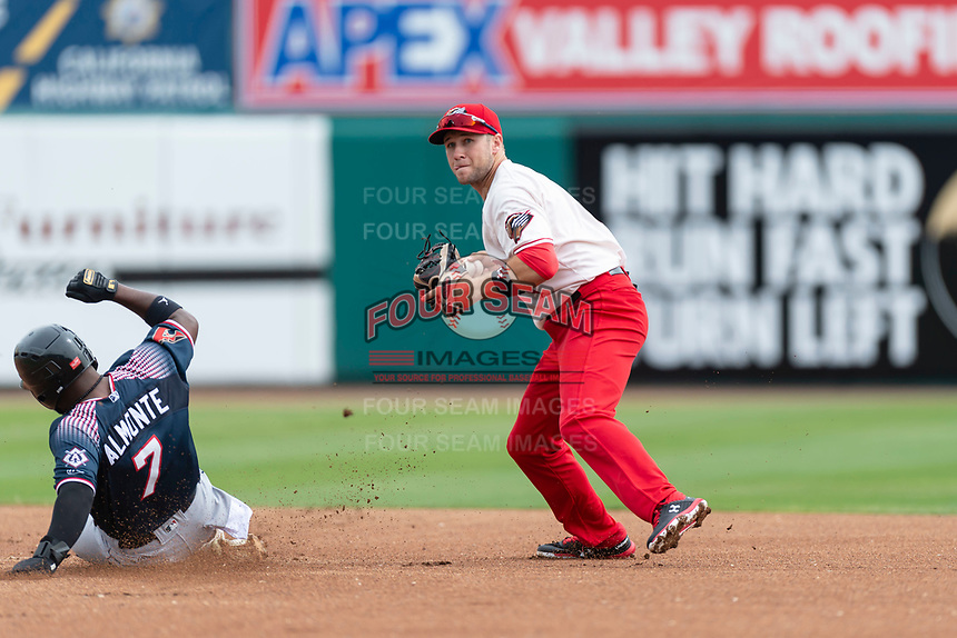Fresno Grizzlies shortstop Carter Kieboom (8) turns a double play during a game against the Reno Aces at Chukchansi Park on April 8, 2019 in Fresno, California. Fresno defeated Reno 7-6. (Zachary Lucy/Four Seam Images)
